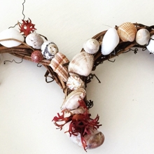Rattan heart shaped wreath decorated with seashells