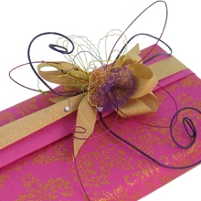 Box wrapped in Indian handmade paper with wire, bead and ribbon decoration
