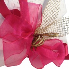 Arona Khan's signature pouch with Indian handmade paper and handmade fabric bow