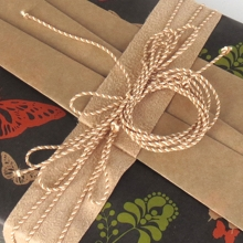 Box wrapped in paper - butterfly design - with bakers twine