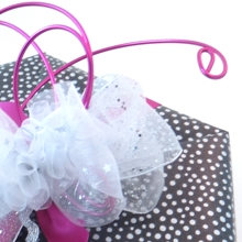 Hexagon wrapped in paper with wire and ribbon decoration