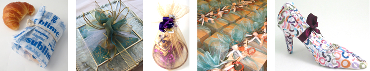 A wrapped croissant, a wrapped glass box, gifts wrapped on a platter, wrapped boxes decorated with seashells, a wrapped shoe
