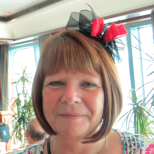 Lady wearing a fascinator she had made