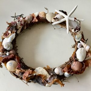 Willow wreath decorated with seashells and seaweed