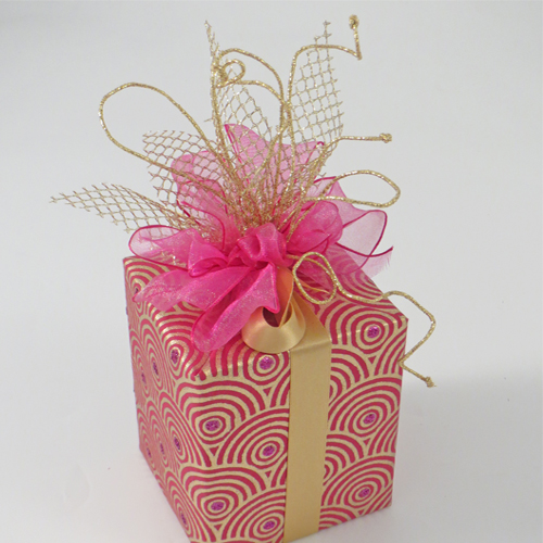Wrapped box decorated with a fabric bow