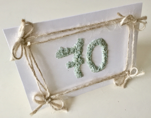 70th birthday card decorated with duck egg shells and twine