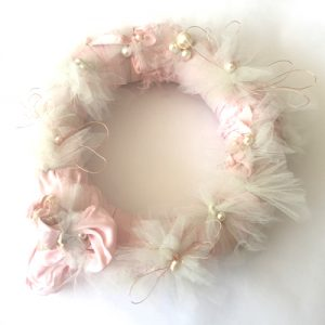 A wreath made from a vintage nightie embellished with tulle, pearls and wire