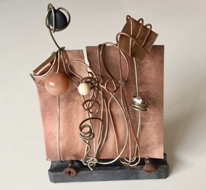 Art piece created from recycled copper, wire, nails and steel
