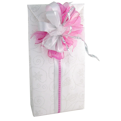 Handmade gift bag and bow made with assorted ribbons